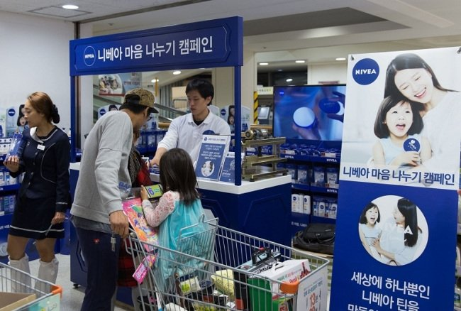 Nivea extends brand marketing to personalized tins
