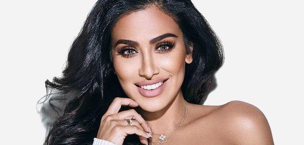Huda Beauty 'vagina lightening' blog post likened to modern day racism